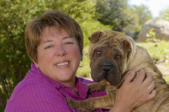 Theresa Strader and puppy mill survivor, Leroy.