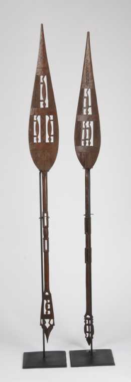This pair of late 19th century ceremonial paddles from Nigeria will be sold.