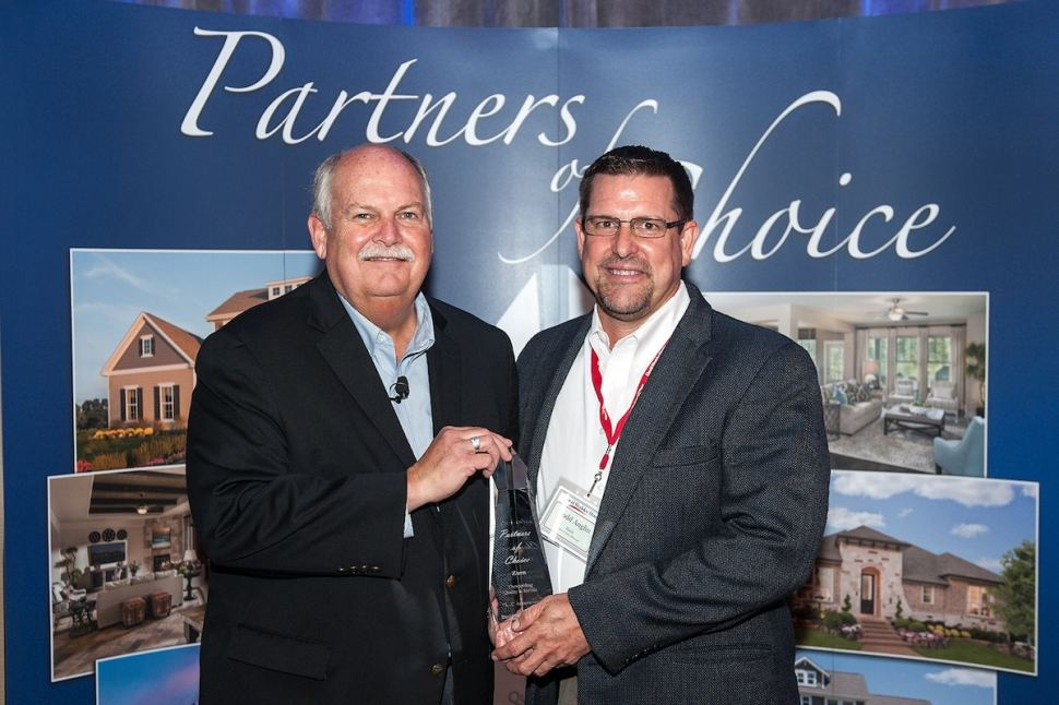 Todd Anglin of Zurn Pex, Inc. (right) Receives Award from David M. Weekley