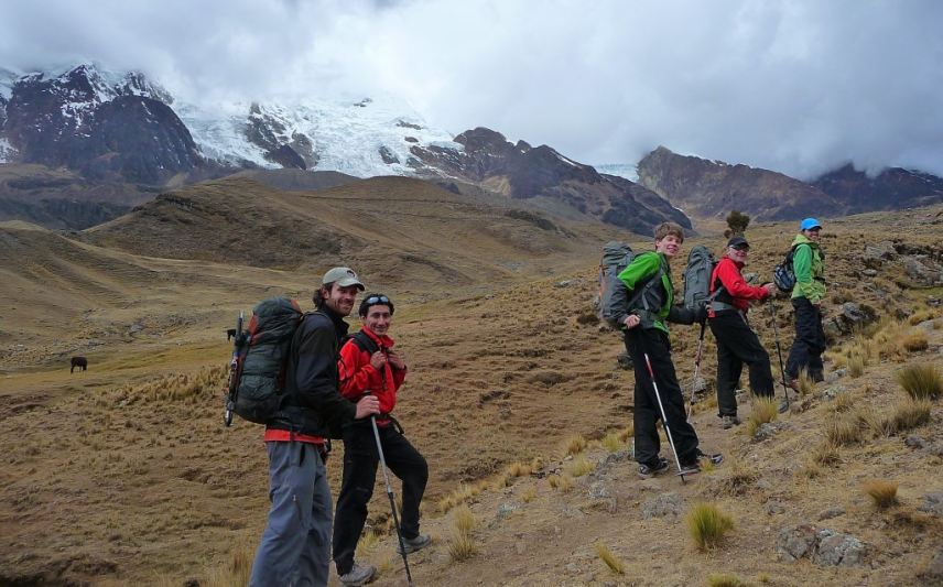Trekking poles provide support and balance on rough terrain.