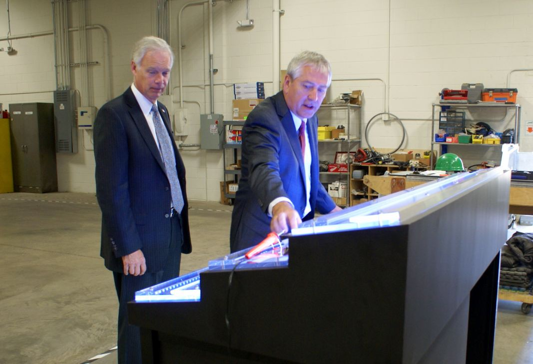 Dave Jentz, company Vice-President, explains a display to U.S. Sen. Ron Johnson