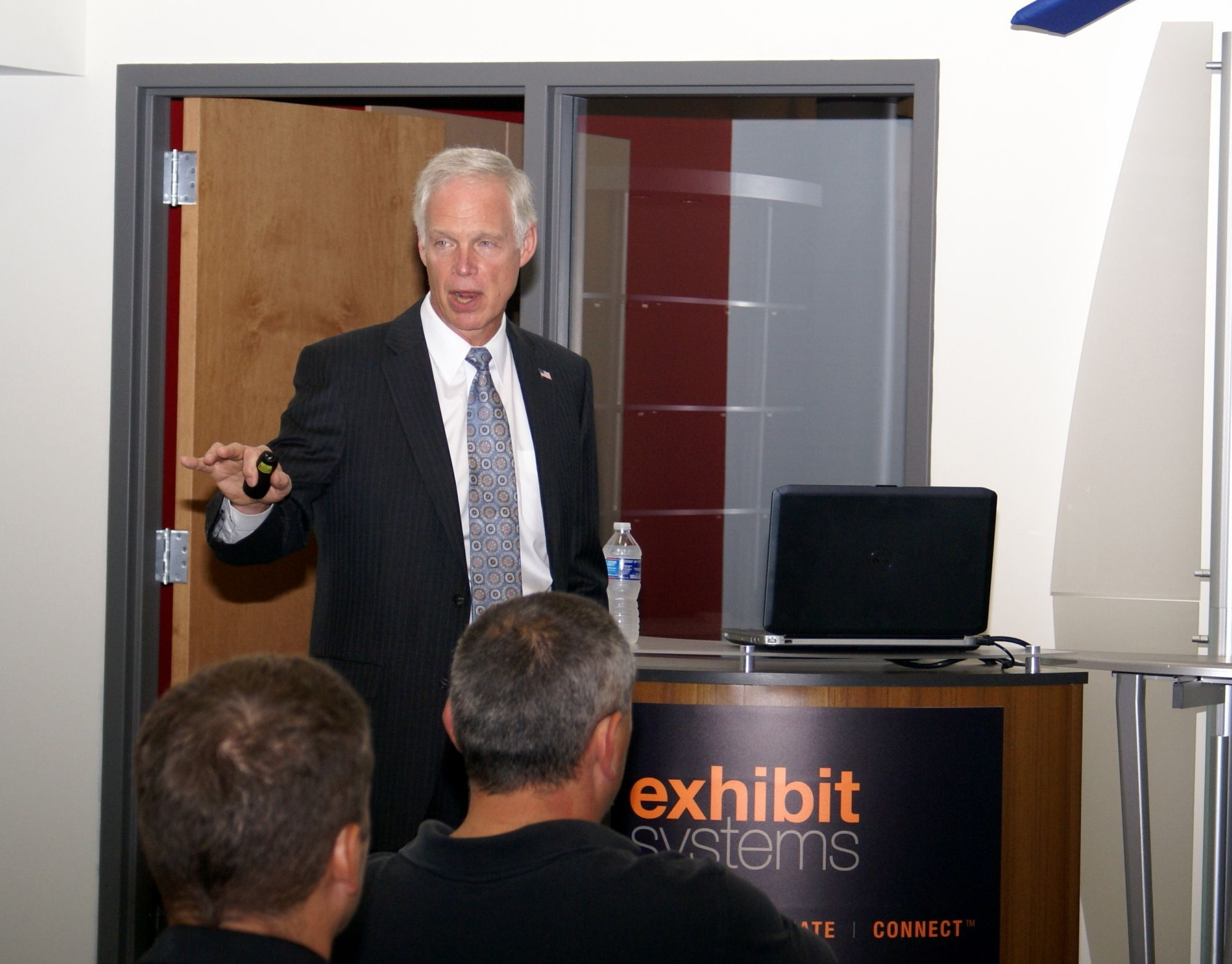 U.S. Sen. Ron Johnson addresses employees at Exhibit Systems Wednesday
