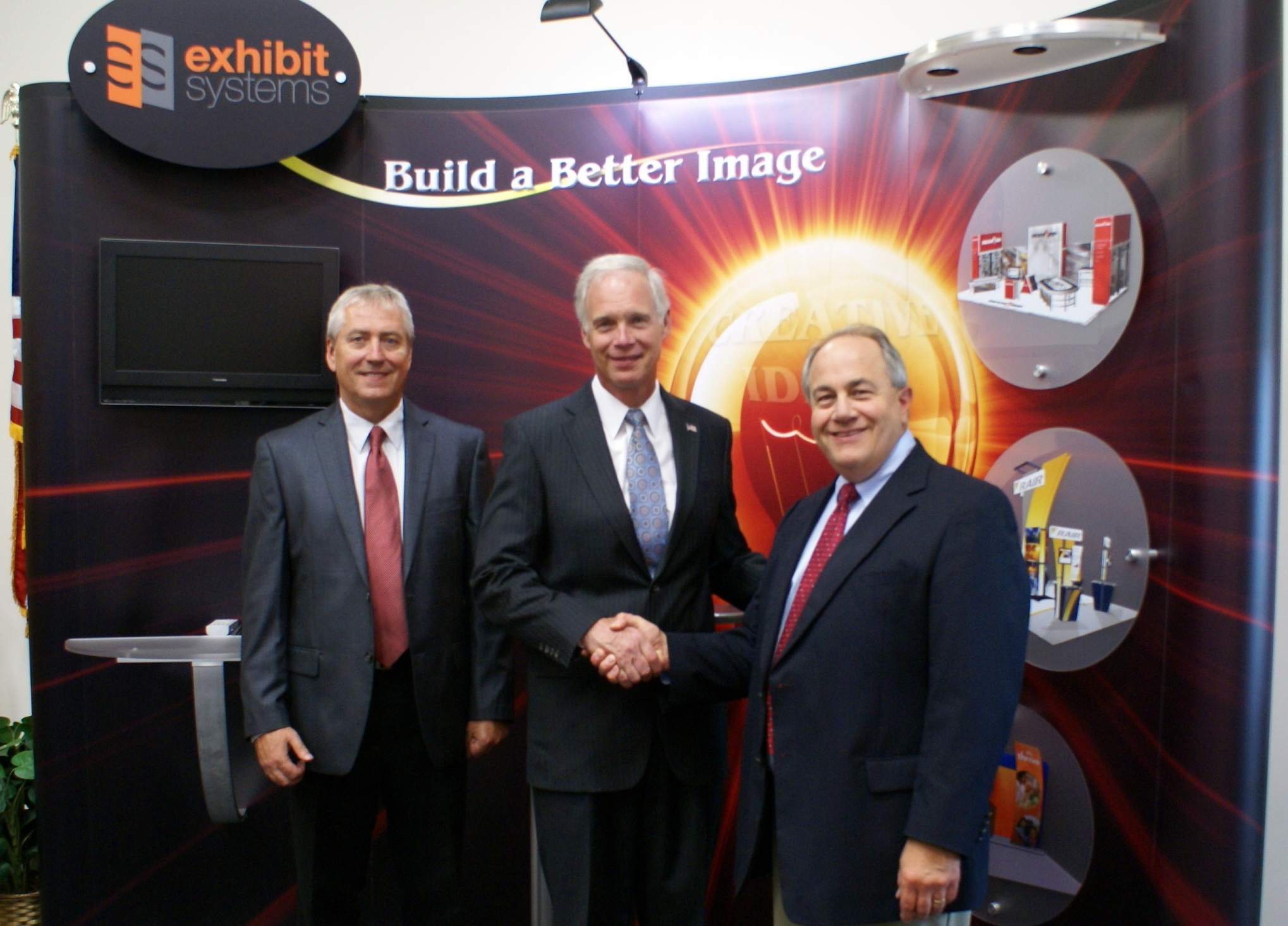 U.S. Sen. Ron Johnson poses for a parting photo with Dave Jentz, Dick Magliocco