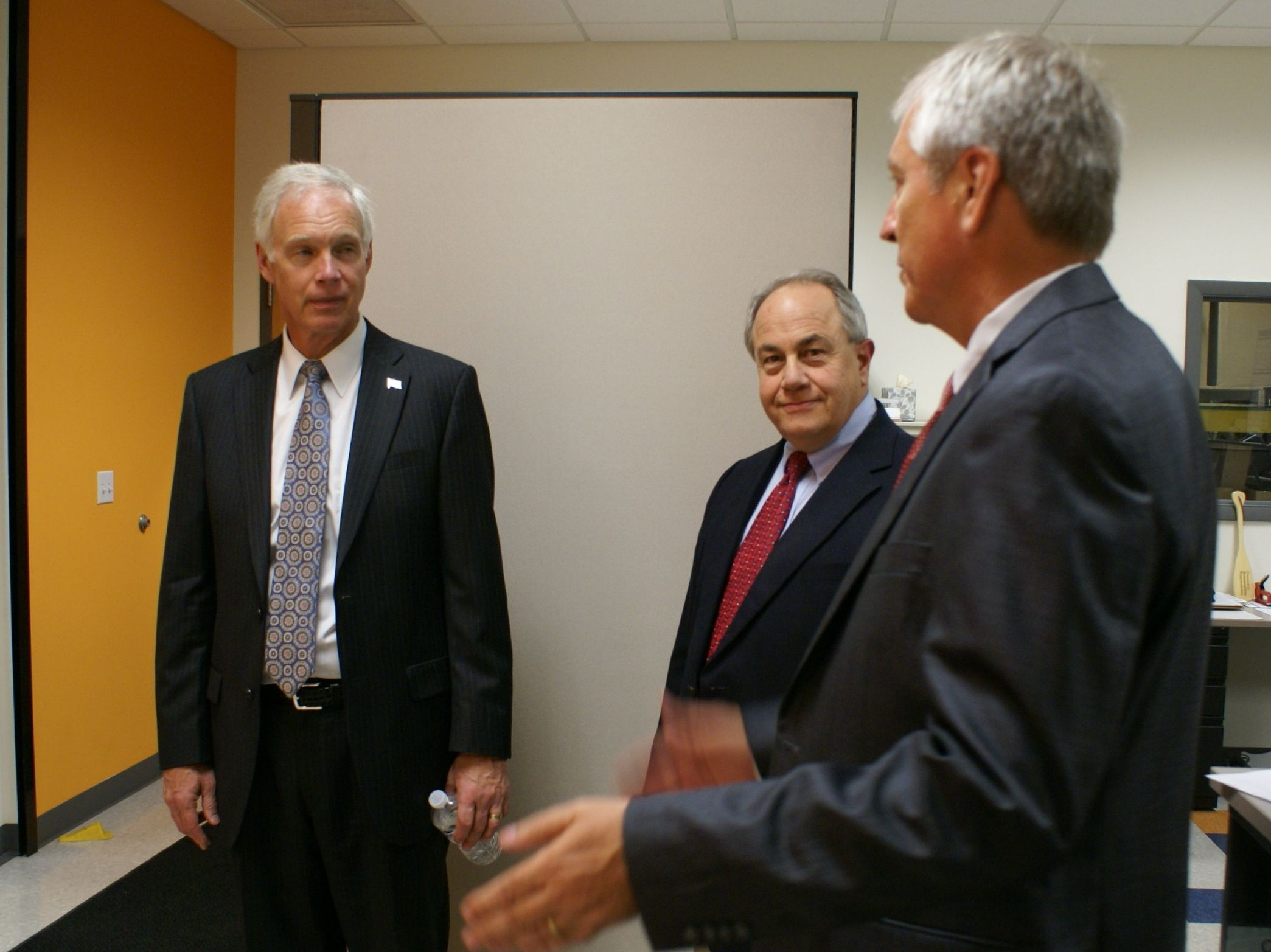 U.S. Sen. Ron Johnson talks with company owners Dick Magliocco and Dave Jentz