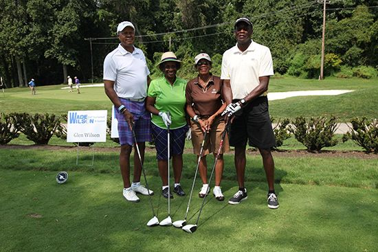 2014 Honorary Chairs Roland and Maxine Coleman and their golfing foursome.