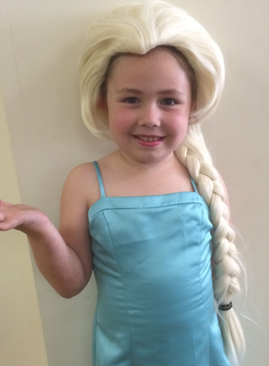 "An Academy student prepares to eat some ""Frozen"" custard in her Elsa costume"