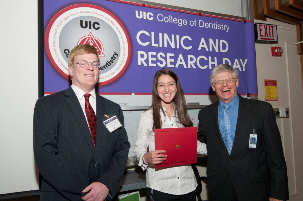Elizabeth Razdolsky, with Dr. David Crowe (left) and Dr. Bill Knight of UIC.