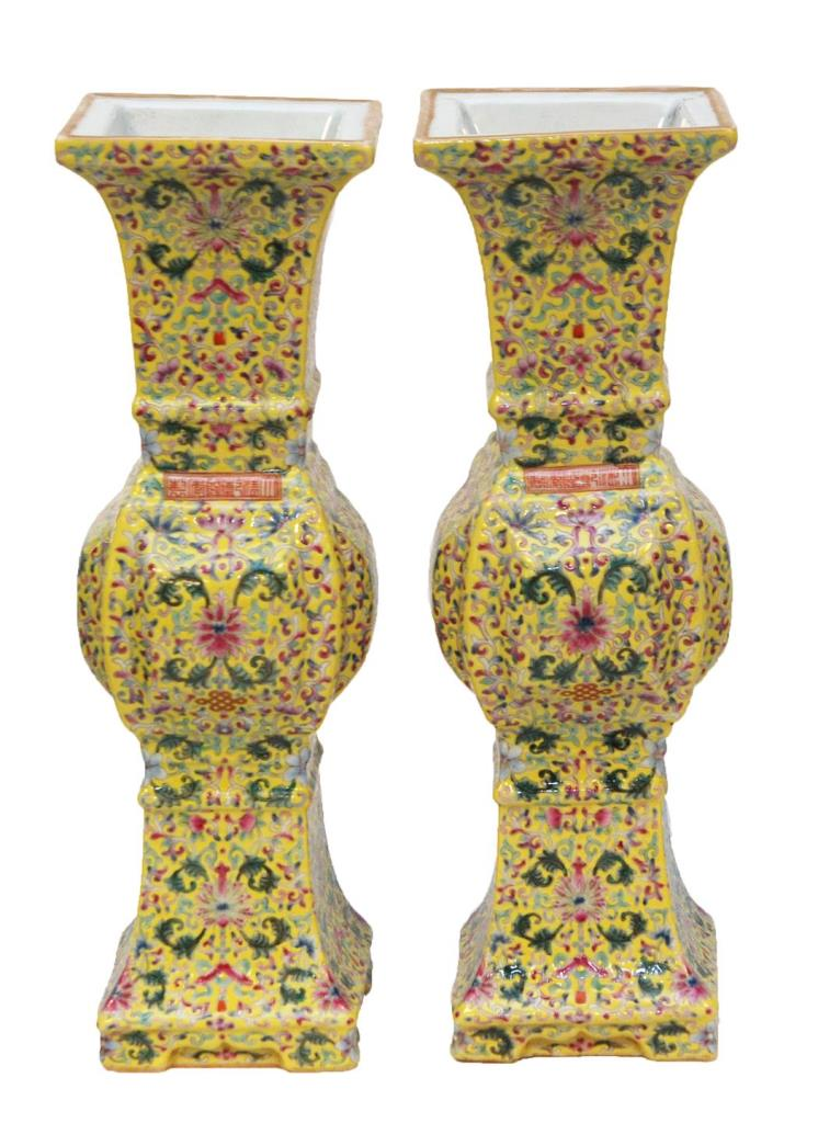 Lovely pair of Chinese hand-painted enameled yellow ground famille rose vases.