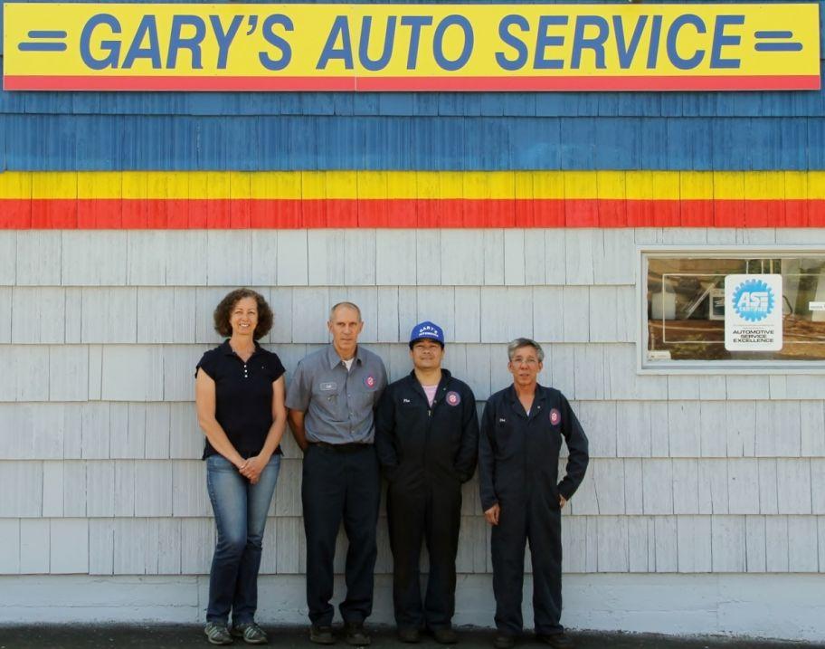Bill and Anita Talus with Mechanics at Gary's Automotive Service