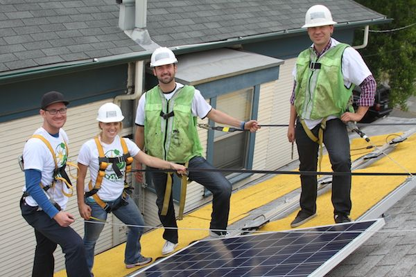 Our team volunteering and installing solar panels!