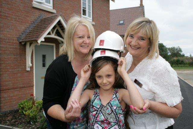 Alison Brown and her daughter with Karen Townsend from Davidsons Homes
