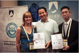 Daniel Uretsky, COO of Allied (center) poses with Anne Gillespie and Hong Lee