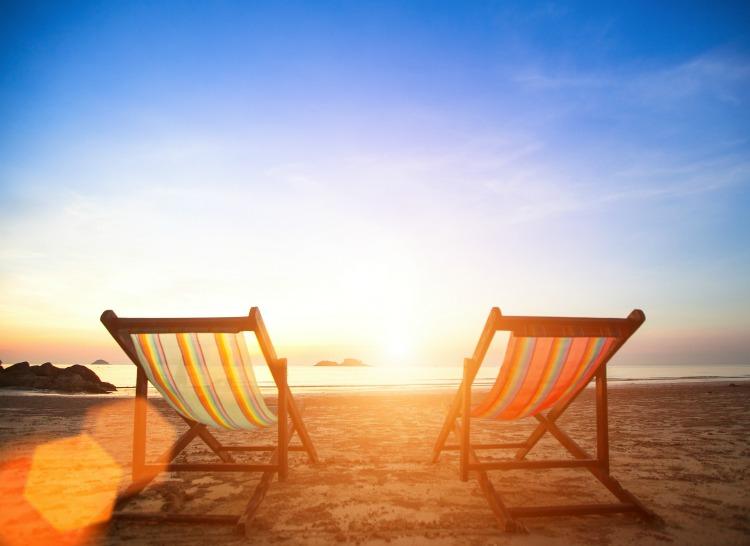 bigstock-Couple-of-beach-chairs-on-sea--62759599