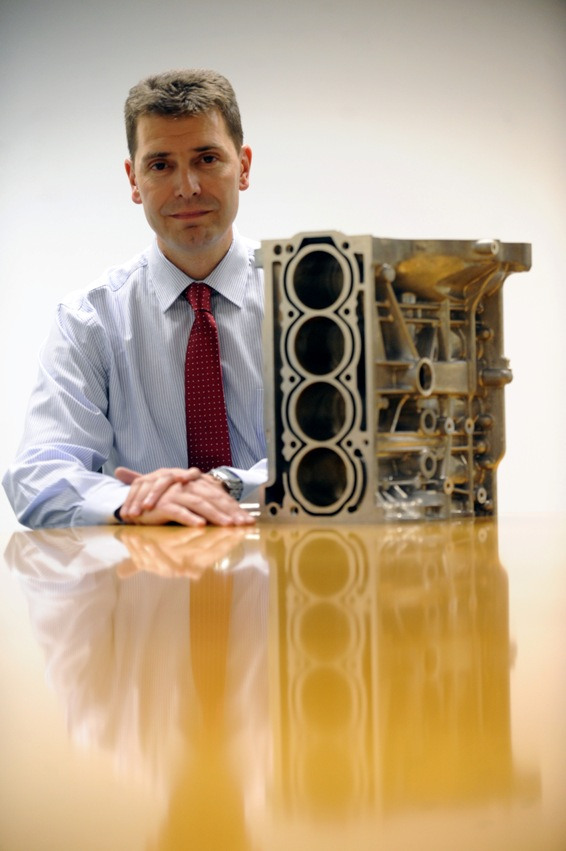 Stephen Hynes, Marketing Director, Ultraseal International with engine block