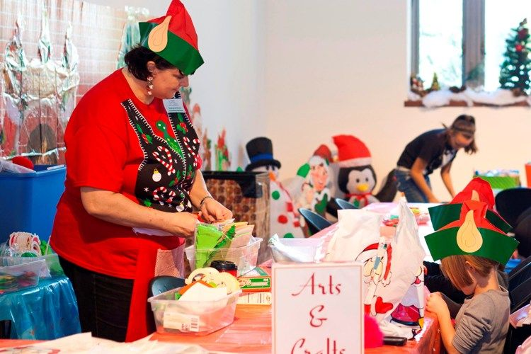 One of Santa's Helpers helps out with crafts