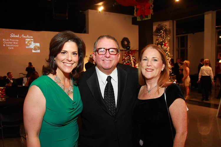 Stacey Adams, Mike Joyce, and his wife pose during the Tux & Trees Gala