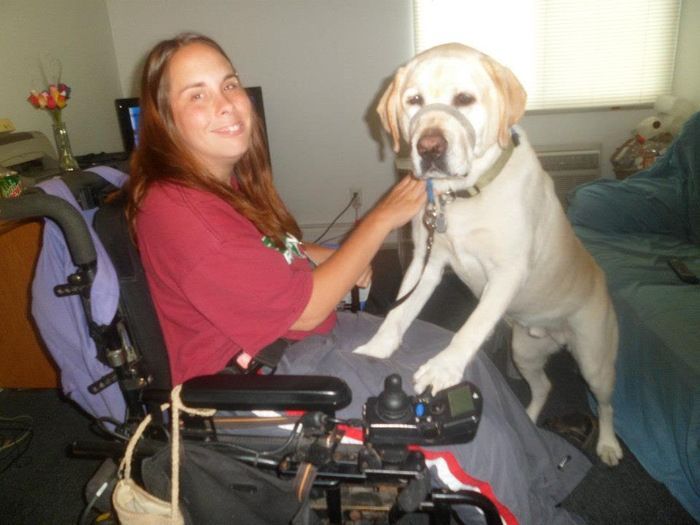 Chris Engstrom and her service dog, Orik