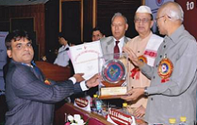TULS Corp MD Mr. Vaibhav Satpute while receiving the award