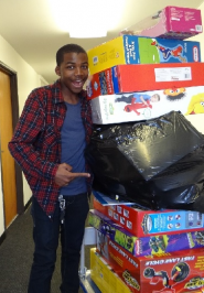 Jemba delivering toys to the Jenesse Center