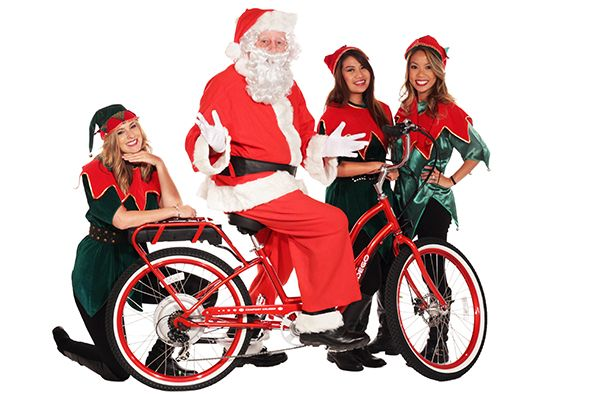 """Santa's team prepares bikes for Pedego's """"12 Days of Christmas"""" Giveaway."""