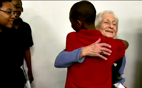 Students line up to hug Holocaust survivor Irene Butter, the film's heroine.