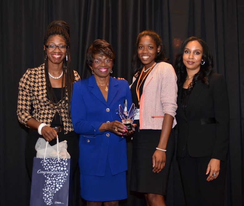 Judge Miles-LaGrange Holding Award With Aspiring Lawyers & Event Founder