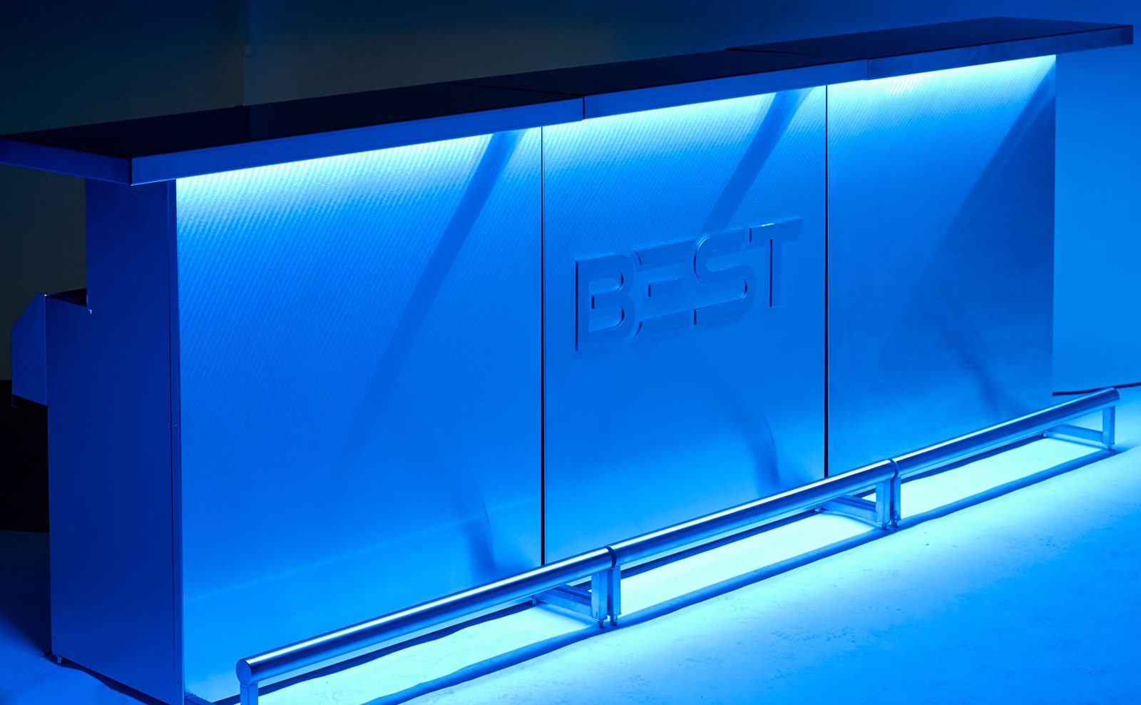 Three DELUX Bars Joined To Form A Long Continuous Bar, With Blue LED Lights  On