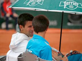 Novak and ball boy at Roland Garros