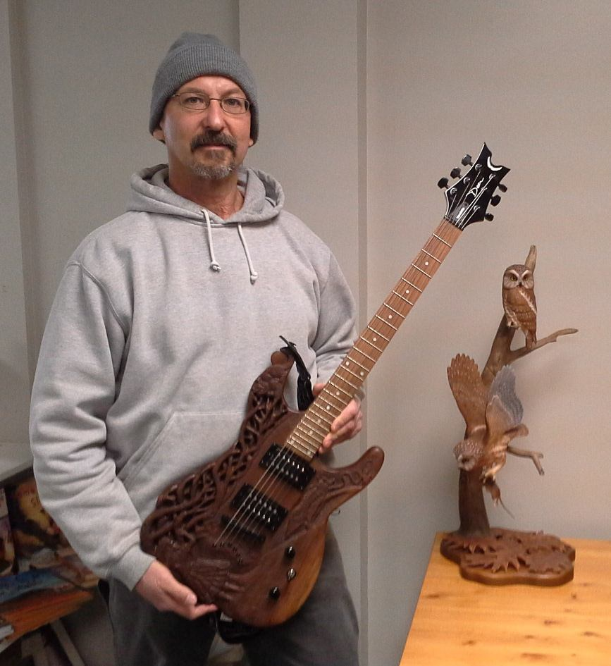 sculptor Mark Goldstein with Alice in Wonderland carved guitar, and Saw-whet Owl