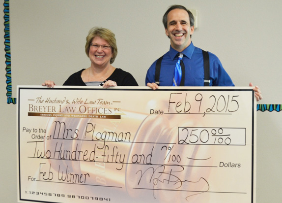 Mrs. Debbie Plogman with attorney Mark Breyer