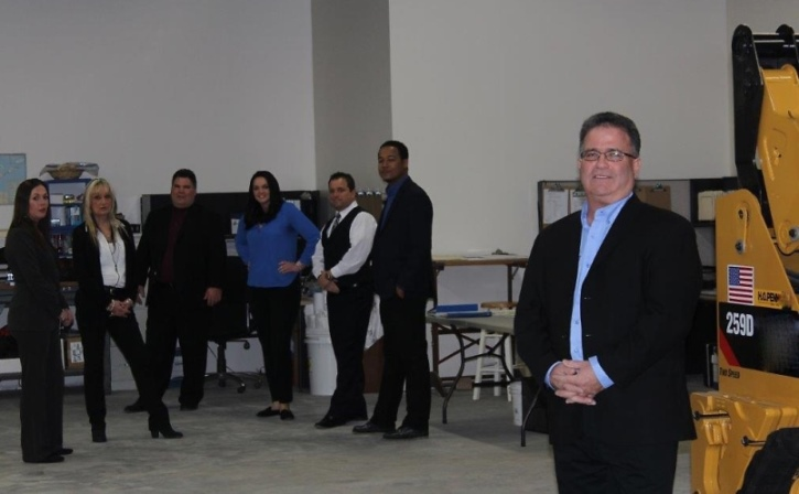 Ultimate in Pool Care, Inc. team members in the company's new warehouse