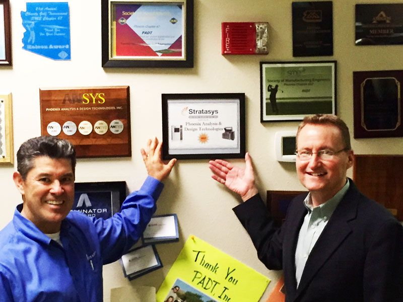 PADT Co-Owner Ward Rand and Sales Manager Mario Vargas hang the new certificate