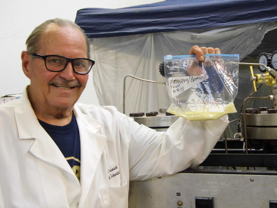 Dr. Joe Resnick Shown with Encapsulator and First Batch of Nano Pollen