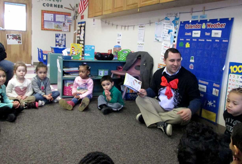 Representative Tobon read to the students