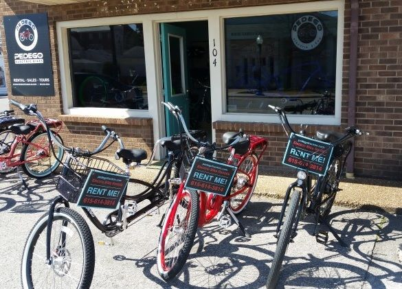 Lively Pedego electric bikes stand ready for riders at Pedego Franklin.