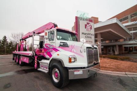"""The """"Reaching for a Cure"""" boom truck in front of Marshfield Clinic"""