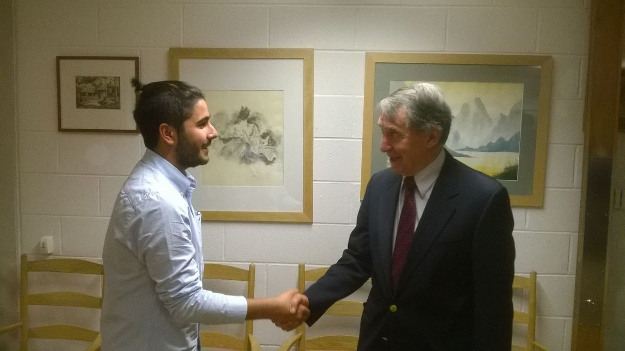 Bedales student Naveed Khalessi shaking hands with Professor Anthony Readhead