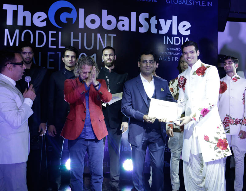 "Mr. Tarun Shienh awading to the winner of ""The Global Style Model Hunt "" Winner"