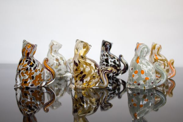 Sitting kitties are hand-sculpted with multi-colored cane.