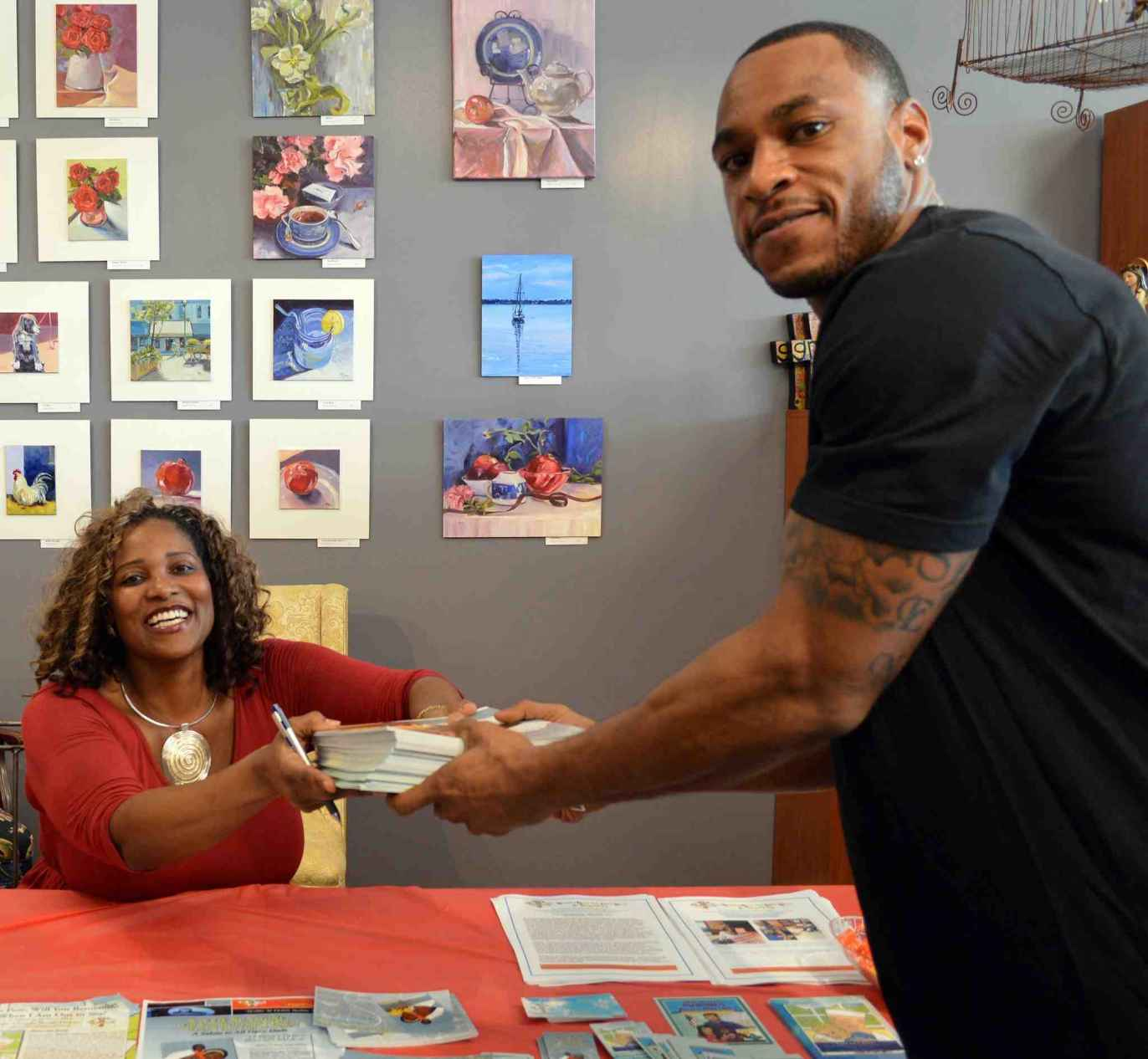 Author, Dr. Chanda N. Holsey w/ NFL's Percy Harvin, Photo Credit: R. Mallett