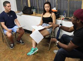 Heidi Li and co-star Jorge Consejo listen to instr