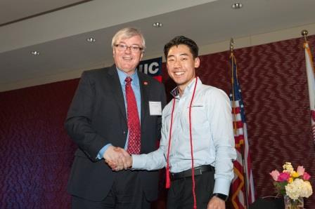 UIC Chancellor Michael Amaridis and student Yale Cho.
