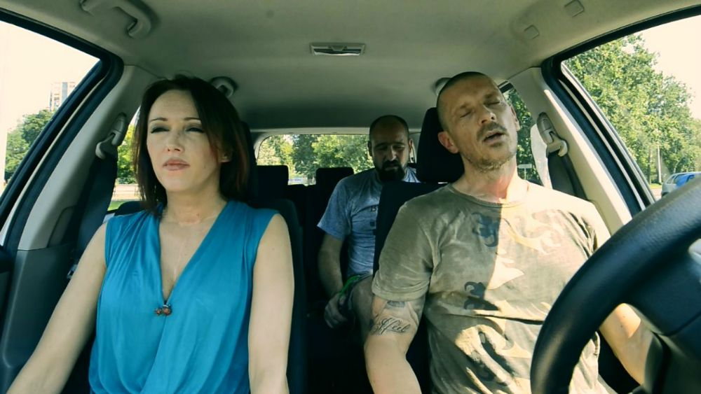 3 humans in a car during a hot summer day