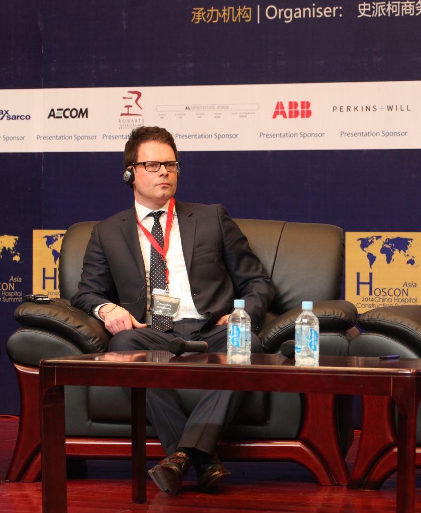Derek Muhs speaking at previous HOSCON Summit