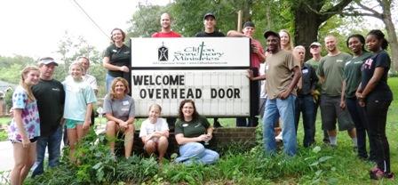 Volunteers from Overhead Door Company of Atlanta, HomeAid, & Clifton Sanctuary