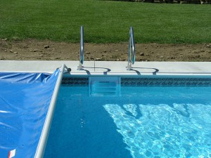 Swimming Pool Covers Essential For Closing Kansas Pools For The Winter Premier Pools And Spas