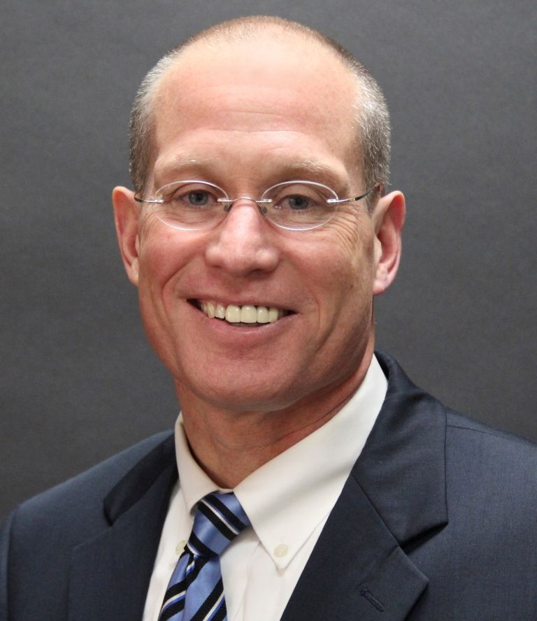 Dr. Michael D. Harner.