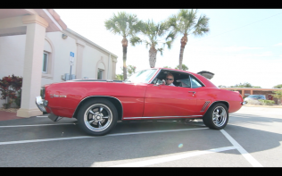 Pastor Robbie O'Brien inside of the Camaro to be given away on Christmas Eve.
