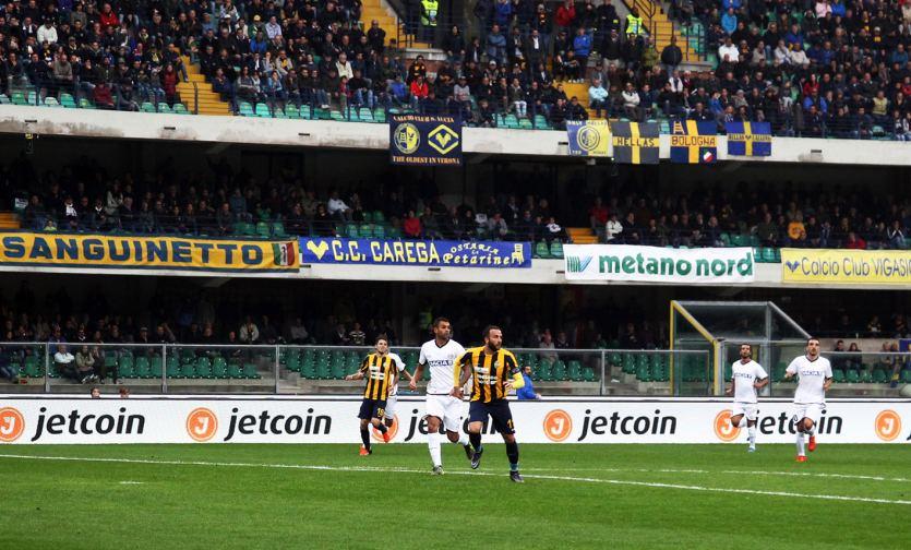 Hellas Verona vs Udinese against digital backdrop of top sponsor Jetcoin