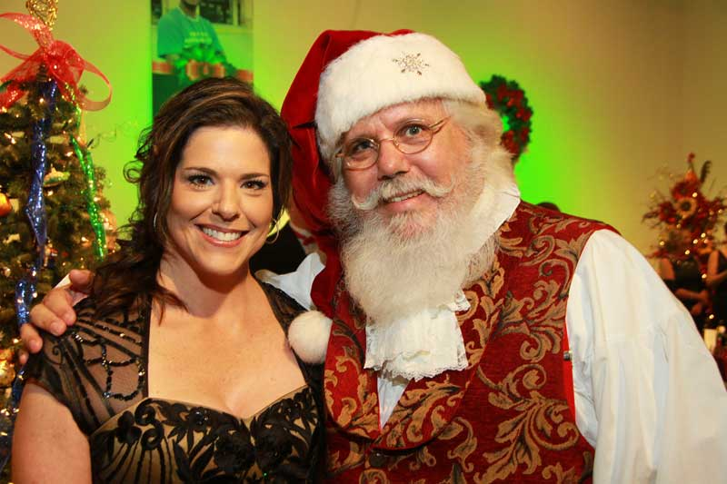 Former WINK Anchor Stacey Adams with Santa at the 2014 Tux & Trees Gala